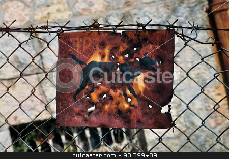 rusty beware of the dog sign stock photo, Rusty beware of the dog sign and chain link fence background. by sirylok