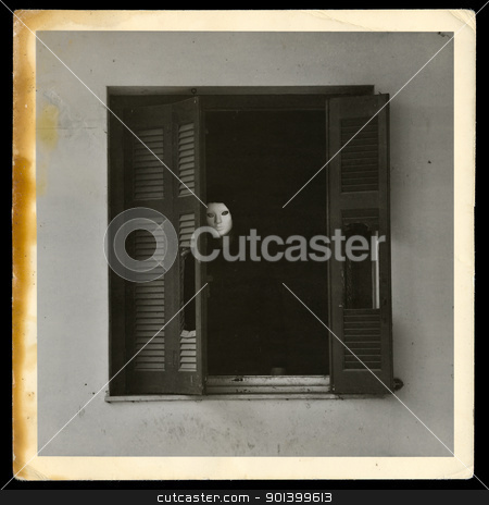 vintage photograph of masked figure stock photo, Vintage photograph of masked figure by the broken windows of abandoned house. by sirylok