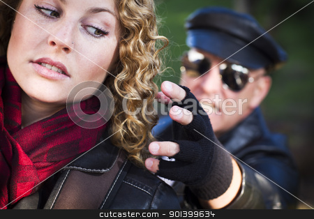 Pretty Young Teen Girl with Mysterious Man Reaching to Grab Her stock photo, Pretty Young Teen Girl with Mysterious Strange Man Reaching to Grab Her. by Andy Dean