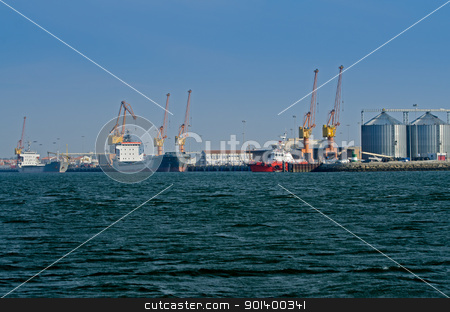 Cargo ship docked in port stock photo, Large cargo ship docked in port. by Homydesign