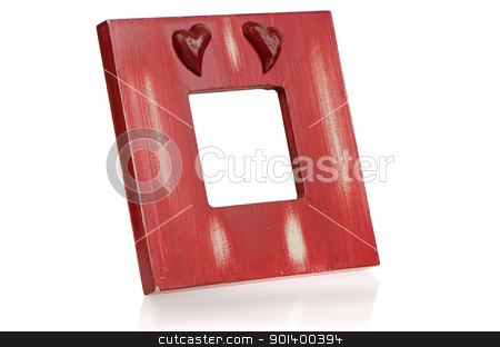 Red wooden picture frame with hearts stock photo, Red wooden picture frame with hearts on white reflective background. by Homydesign