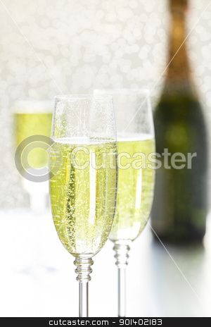 Glasses Of Champagne stock photo, Close up photograph of two glasses of champagne by mpessaris