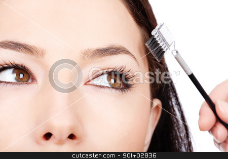 pretty woman applying make up stock photo, pretty woman applying make up, isolated on white background by iMarin