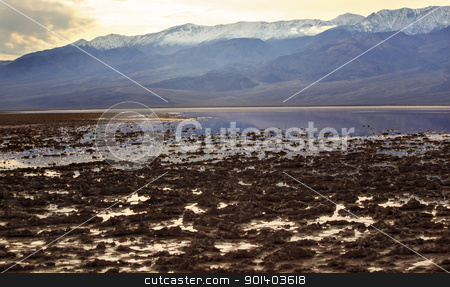 Badwater with Black Mountains Death Valley National Park Califor stock photo, Salt Badwater Basin Black Mountains Death Valley National Park California Lowest spot in the Western Hemisphere 282 Feet below Sea Level by William Perry