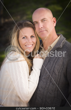 Attractive Couple Wearing Sweaters in Park stock photo, Attractive Couple Wearing Sweaters Outdoors in the Park. by Andy Dean