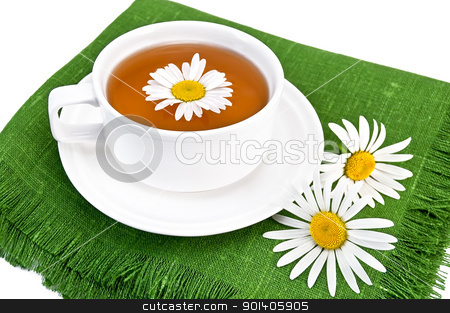 Herbal tea in a white cup with camomile stock photo, Herbal tea in a  white cup with daisies on the green napkin, isolated on a white background by rezkrr
