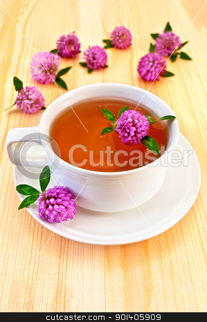 Herbal tea with clover stock photo, Herbal tea with clover in the white porcelain cup, clover flowers on a wooden board by rezkrr