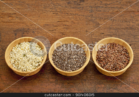 chia, flax and hemp seeds stock photo, chia, flax and hemp healthy seeds in small wooden bowls by Marek Uliasz