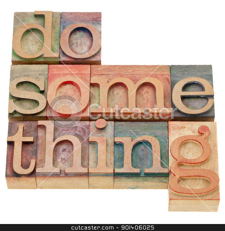do something in letterpress type stock photo, do something - a motivational phrase - isolated words in vintage wood letterpress printing blocks by Marek Uliasz