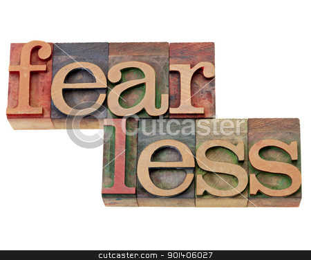 fearless word in letterpress type stock photo, fearless - isolated word in vintage wood letterpress printing block by Marek Uliasz