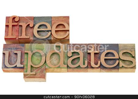 free updates stock photo, free updates - isolated text in vintage wood letterpress printing blocks by Marek Uliasz
