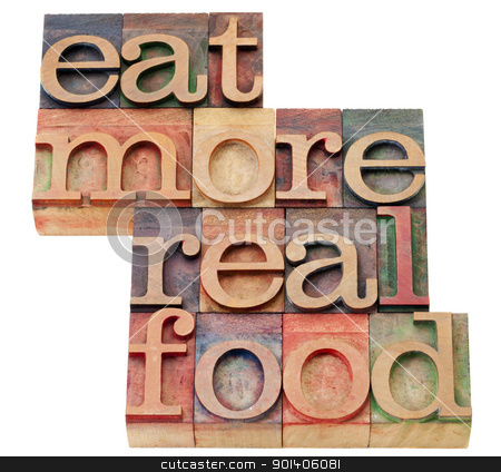 eat more real food stock photo, eat more real food - healthy lifestyle concept - isolated text in vintage wood letterpress printing blocks by Marek Uliasz