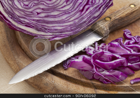 red cabbage and knife stock photo, red cabbage and knife on a wooden cutting board by Marek Uliasz