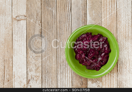 cranberry sauce  stock photo, a bowl of cranberry sauce on grunge white painted wood table by Marek Uliasz