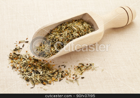 scoop of green tea stock photo, scoop of green tea with orange blossom on canvas background by Marek Uliasz