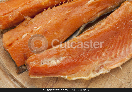 smoked Yukon salmon stock photo, three pieces of smoked Yukon salmon on wooden board by Marek Uliasz