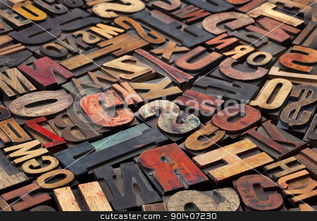 antique letterpress printing blocks stock photo, antique wood letterpress printing blocks with color ink patina, random collection of different size and style by Marek Uliasz
