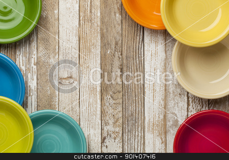 old wood and color bowls stock photo, copy space on a grunge white painted  wood table surrounded by color ceramic bowls by Marek Uliasz