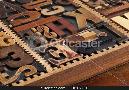 antique letterpress prinitng blocks stock photo, a variety of antique wood letterpress printing blocks in vintage typesetter box by Marek Uliasz