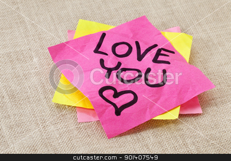 love you - office romance stock photo, office romance concept - love you text handwritten on red sticky note by Marek Uliasz