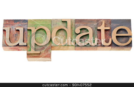 update - word in letterpress type stock photo, update - isolated word in vintage wood letterpress printing blocks by Marek Uliasz