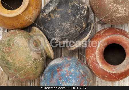 grunge clay pots stock photo, clay pots (planters) with a color grunge finish on wooden surface by Marek Uliasz