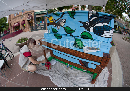 mural painter at work stock photo, FORT COLLINS, COLORADO, USA - JUNE 19, 2011: Artist Ren Burke is painting Birdsongs mural on the piano in Fort Collins Old Town Square as part of Pianos About Town public art program. Fisheye lens perpsective. June 19, 2011. by Marek Uliasz