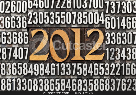 year 2012 in letterpress type stock photo, 2012 number in vintage wood letterpress priniting blocks surrounded by random metal numbers by Marek Uliasz