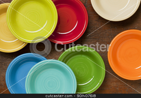colorful ceramic bowls abstract stock photo, colorful ceramic bowls on a grunge weathered wood background - top view by Marek Uliasz