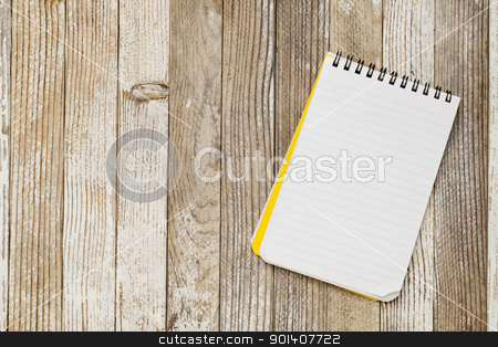 notebook on a rustic table stock photo, a small lined notebook on a rustic grunge wooden table by Marek Uliasz