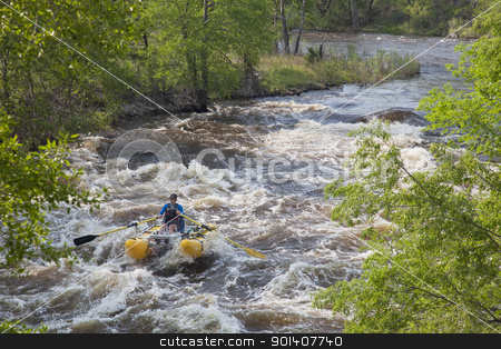 whitewater rafters  stock photo, Fort Collins, Colorado, USA - June 4, 2011: White water rafter enjoys floating over Maddog Rapid on Cache la Poudre River west of Fort Collins, Colorado by Marek Uliasz