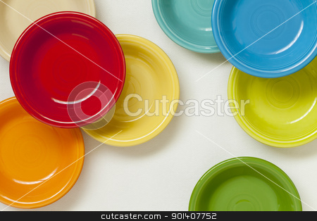 colorful ceramic bowls stock photo, colorful ceramic bowls on white tablecloth - top view by Marek Uliasz