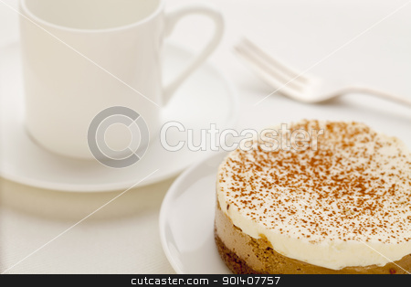 mocha cheesecake stock photo, a round mocha cheesecake  on platte with a cup espresso coffee by Marek Uliasz