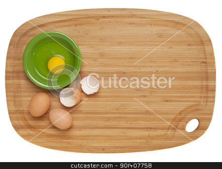 eggs on bamboo board stock photo, food preparation concept - broken eggs and ceramic bowl on bamboo cutting board, isolated on white by Marek Uliasz