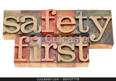 safety first in letterpress type stock photo, safety first - isolated phrase in vintage wood letterpress printing blocks by Marek Uliasz