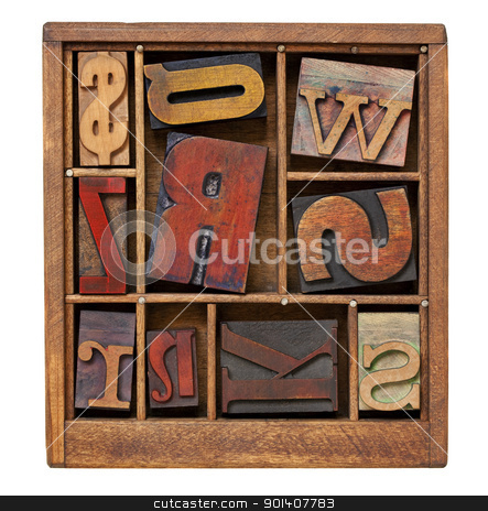 vintage letterpress printing blocks stock photo, vintage letterpress printing blocks in small wooden typesetter box with dividers, isolated on white by Marek Uliasz