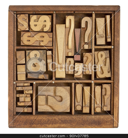 punctuation symbols in letterpress type stock photo, question mark, exclamation point, ampersand, and other punctuation symbols - vintage letterpress printing blocks in small wooden typesetter box with dividers, isolated on white by Marek Uliasz