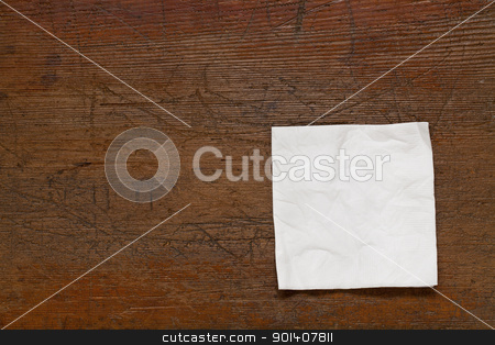 white cocktail napkin  stock photo, white cocktail napkin on old scratched grunge wood table by Marek Uliasz