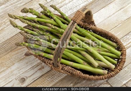 green asparagus in wicker basket stock photo, green asparagus in  wicker basket on grunge white painted wood background by Marek Uliasz