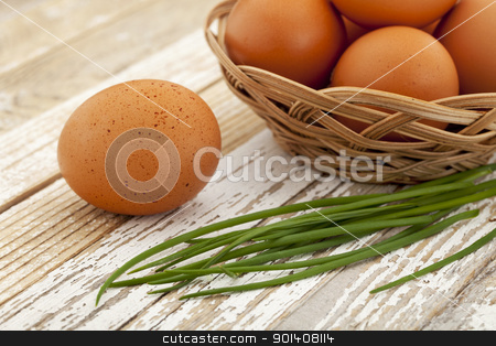 eggs and green chive stock photo, Easter motif - brown chicken eggs in a basket and green chives on a grunge white wooden surface by Marek Uliasz
