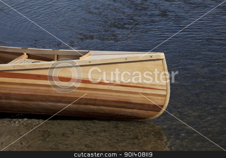 bow of wooden canoe stock photo, bow of beautiful classic wooden canoe home build from stripes of different types of wood, river shore by Marek Uliasz