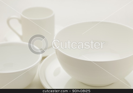 white china abstract stock photo, white china bowls and coffee cup, selective focus abstract by Marek Uliasz