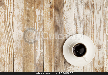 coffee cup on grunge table stock photo, espresso coffee in a white china cup over grunge wood surface with paint peeling off by Marek Uliasz