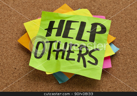 help others reminder stock photo, help others reminder on sticky note posted on a cork board by Marek Uliasz