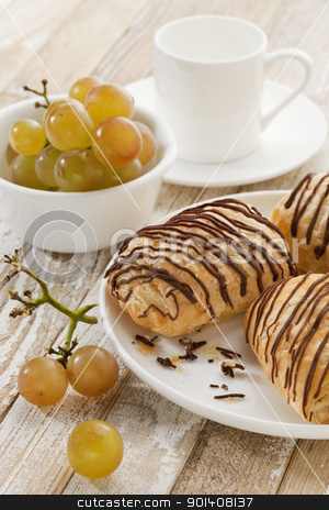 chocolate croissants, grapes and coffee stock photo, mini chocolate croissants, grapes and coffee cup on a rustic wood table by Marek Uliasz