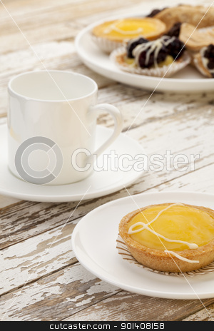 lemon tart and coffee stock photo, lemon mini tart and espresso coffee on a rustic wooden table by Marek Uliasz