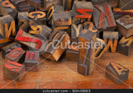 letterpress printing blocks with exclamation point stock photo, a variety of vintage wooden letterpress printing blocks, stained by color inks,  placed randomly on an old wood surface, focus on exclamation point by Marek Uliasz