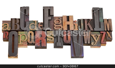 alphabet in letterpress printing blocks stock photo, English alphabet abstract in antique wood letterpress printing blocks of different sizes and styles, isolated on white by Marek Uliasz