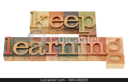keep learning in letterpress type stock photo, continuous education concept - keep learning words in vintage grunge wood letterpress printing blocks, isolated on white by Marek Uliasz