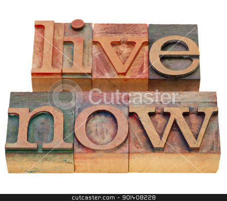 live now phrase in letterpress type stock photo, live now reminder in vintage wood letterpress type, stained by color inks, isolated on white by Marek Uliasz